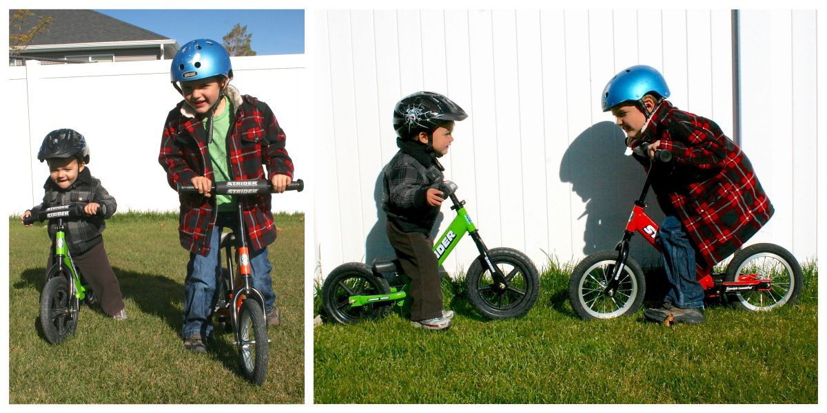 two brothers on Strider bikes. One is 18 months and the other is 5.