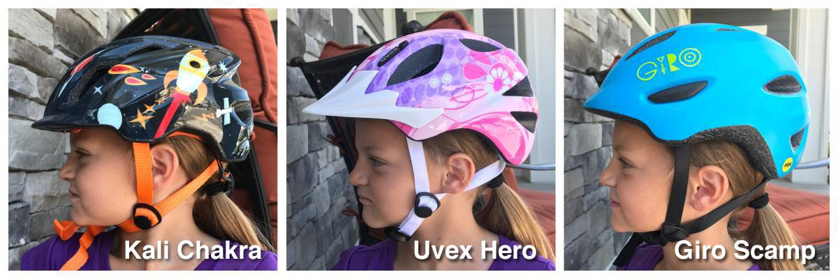 Side shot of 5 year old wearing Kali Chakra, Uvex Hero, and giro Scamp helmets. The Kali Chakra comes lowest on her forehead,