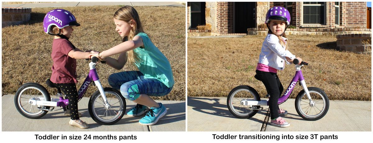 toddler in size 24 months pants and toddler in 3T pants both on the woom 1 balance bike in purple