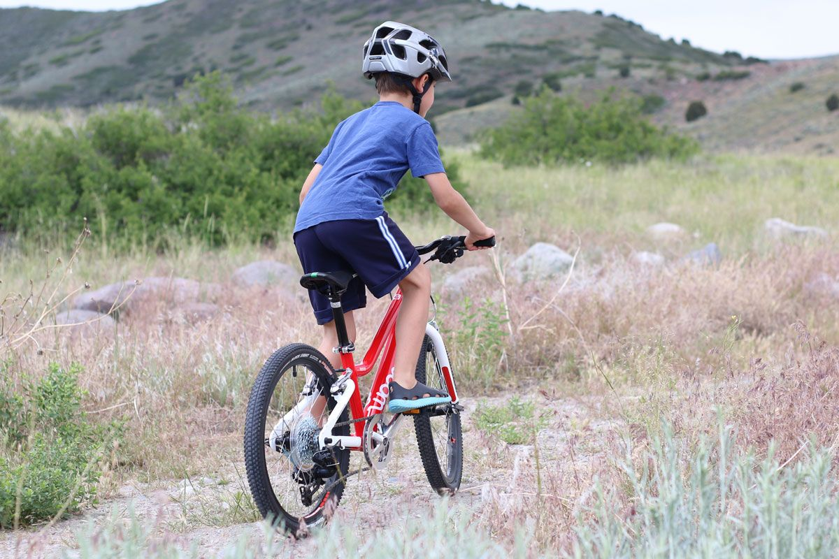 6 year old riding woom 4 on a mountain trail