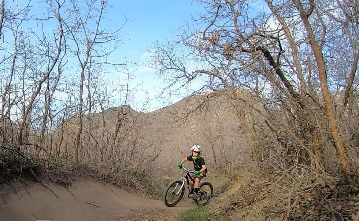 9 year old riding single track on woom OFF AIR kids mountain bike