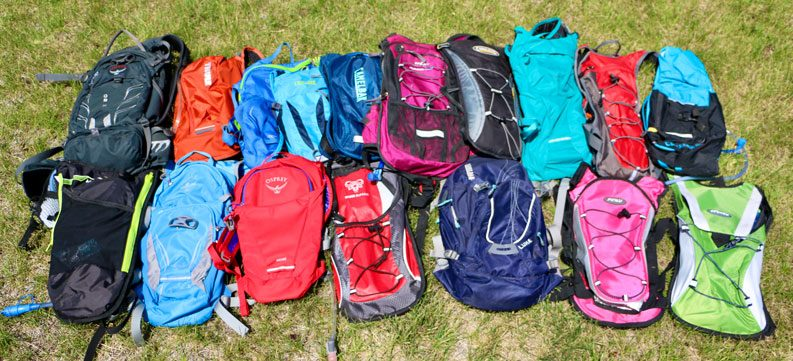 a large group of hydration packs spread out on the grass
