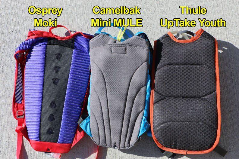 Comparison picture of the rear panels of the Osprey Moki, Camelbak Mini MULE and the Thule Uptake Youth