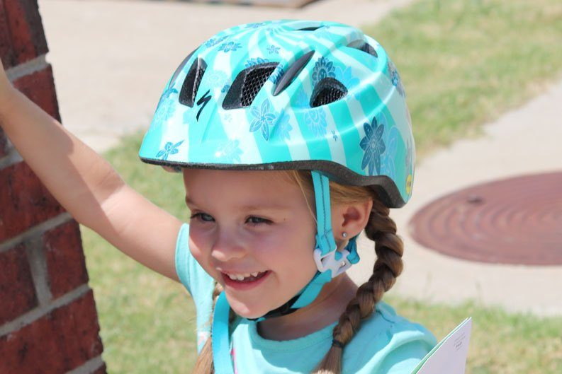 3 year old wearing Specialized Mio toddler helmet