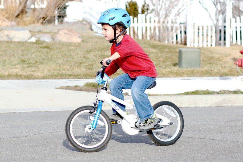 image of a child riding a pedal bike