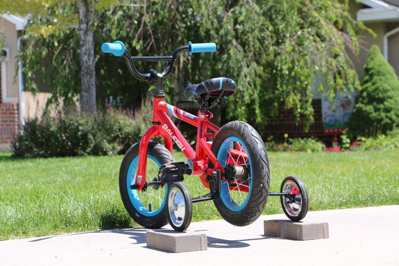 Raleigh MXR 12 kids bike with training wheels propped up to use as a training.  To help kids learn how to pedal.