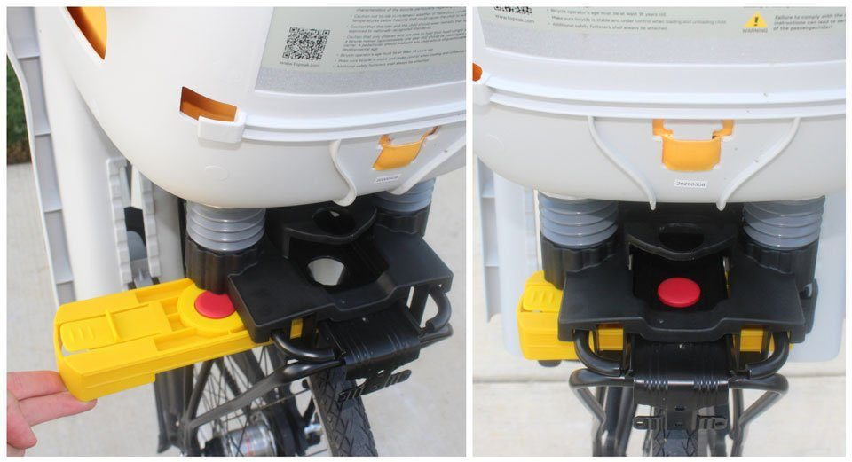 Yellow mounting block being inserted into the bottom of the Topeak BabySeat II