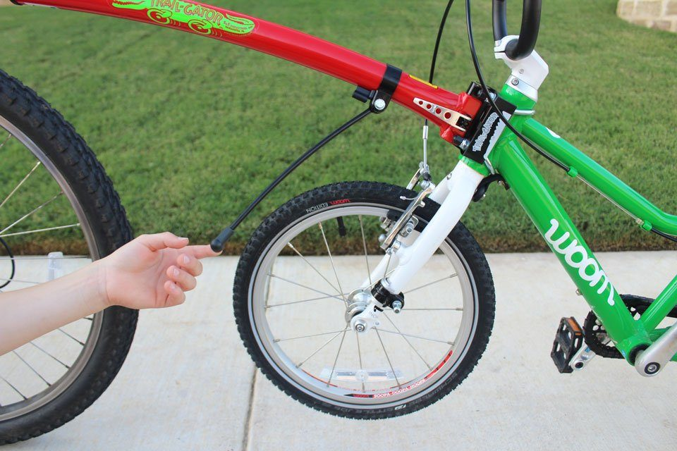Swinging Trail Gator handlebar stabilizer rod down towards child bike
