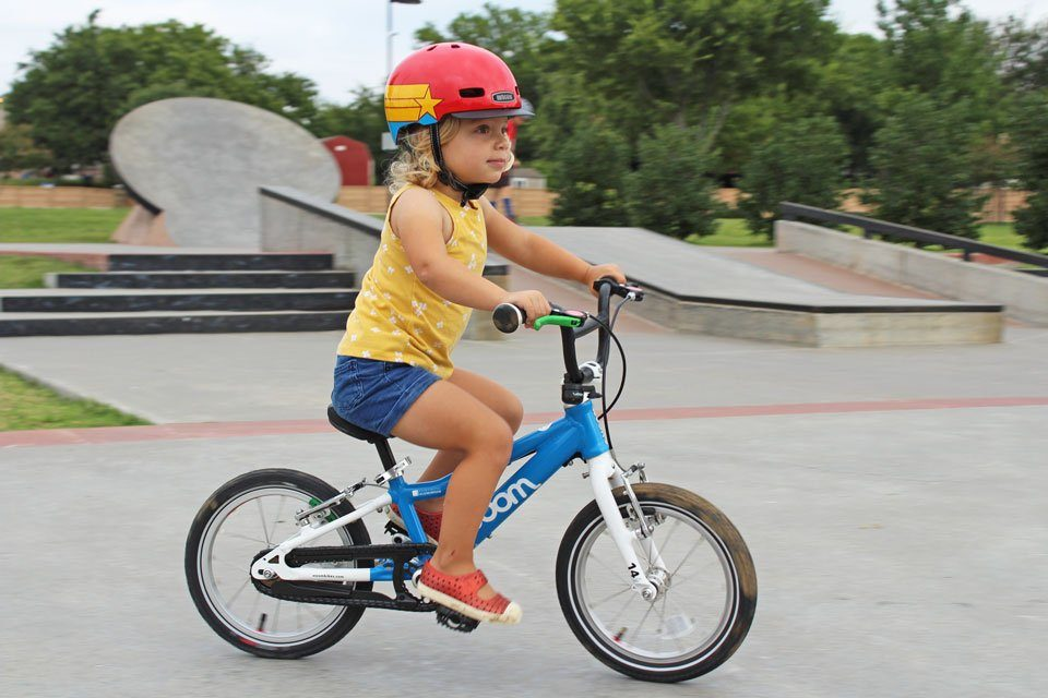 toddler riding woom bikes 14 inch bike at the skate park