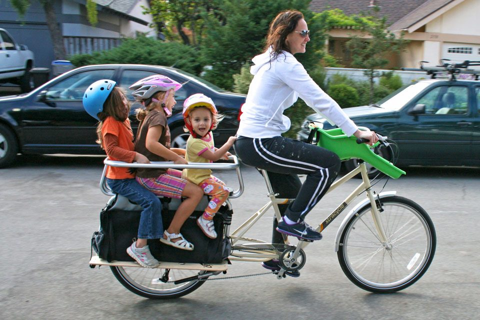 Mom and three kids riding in Xtracycle cargo bike
