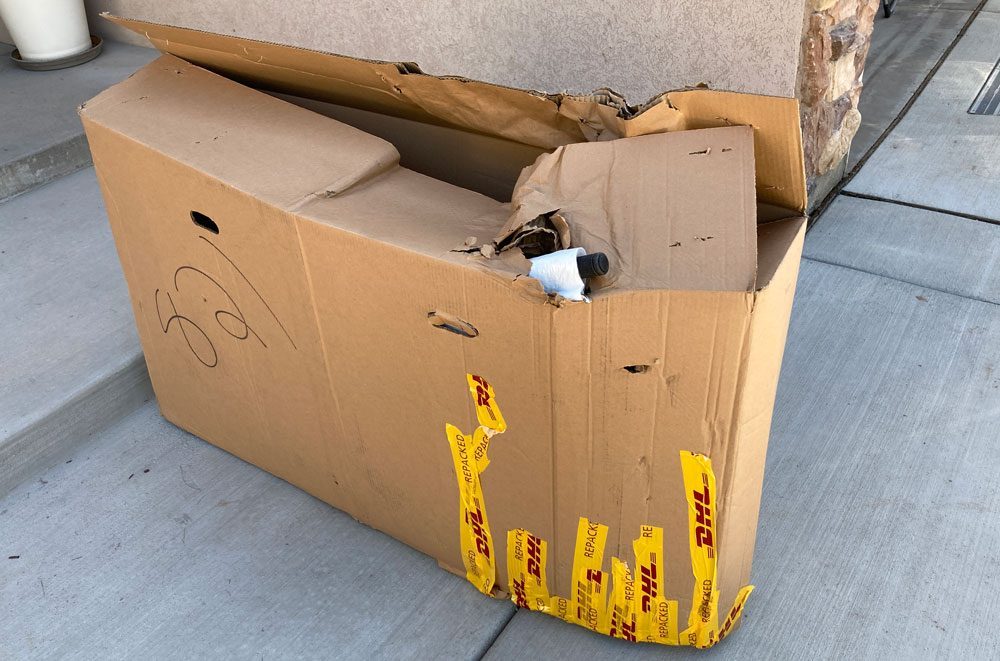 Wrecked up shipping box of Vitus 20 inch kids bike.